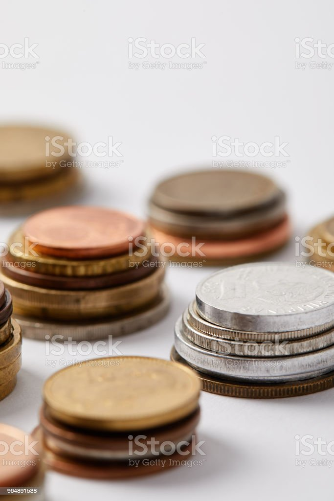close-up shot of stacks of various coins on white royalty-free stock photo