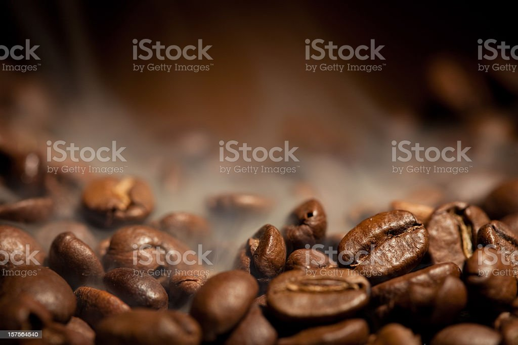 A close-up shot of steamy coffee beans stock photo