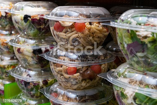 A closeup shot of tasty food in plastic containers in the shop