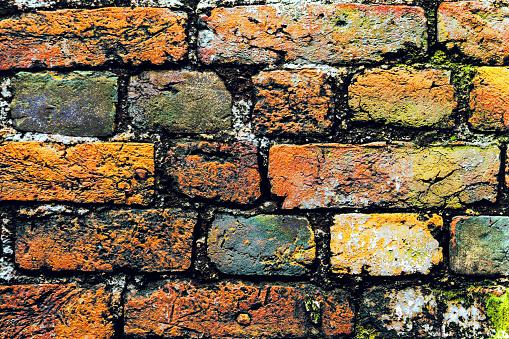A close-up shot of the old rough brick masonry wall lined