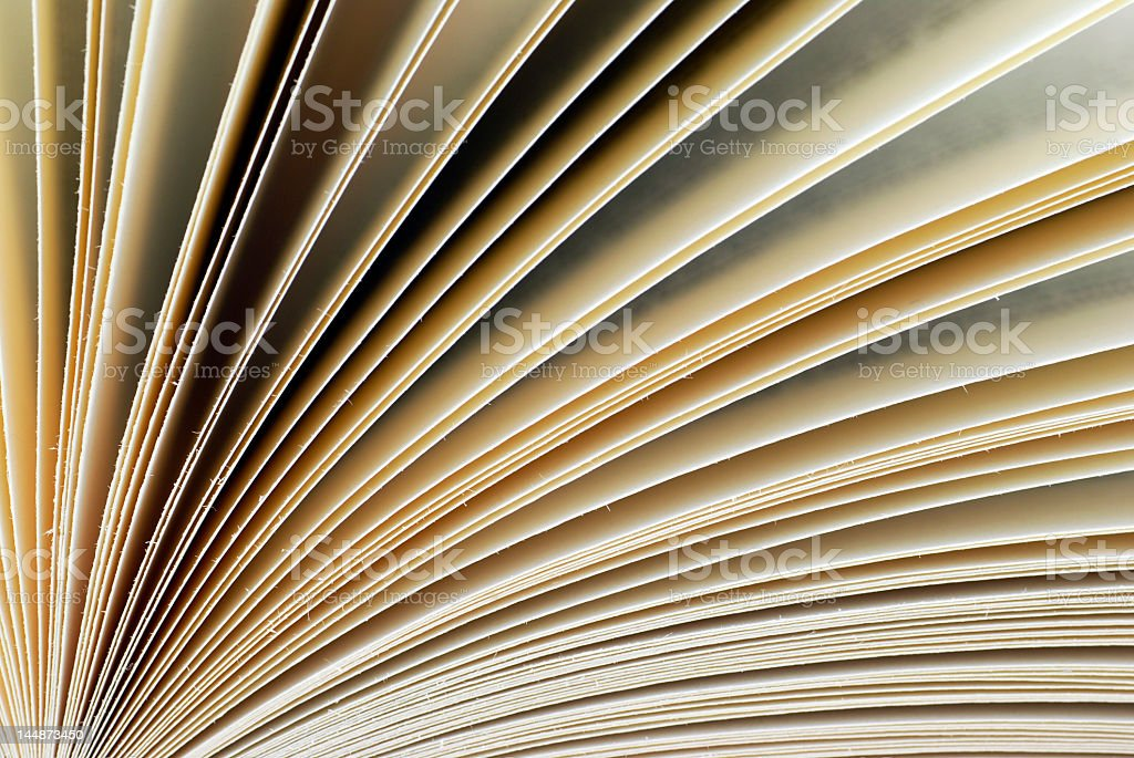Close-up shot of the pages of a book being fanned out royalty-free stock photo