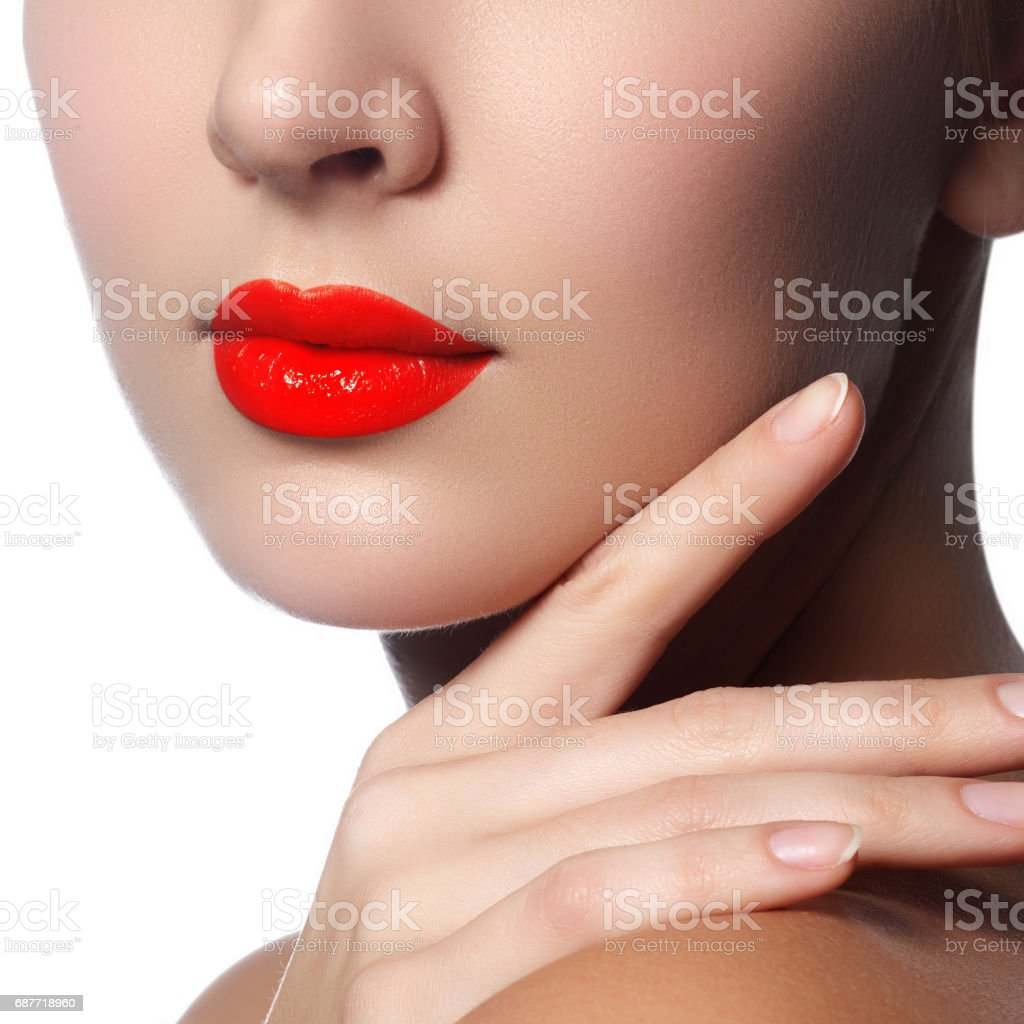 Close-up shot of woman lips with glossy red lipstick. Glamour re stock photo
