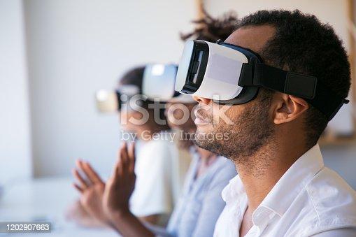 istock Closeup shot of young man testing virtual reality headset 1202907663
