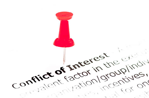 closeup shot over words conflict of interest on paper - interest rate stock photos and pictures