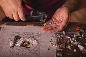 Closeup shots of man working on mosaic