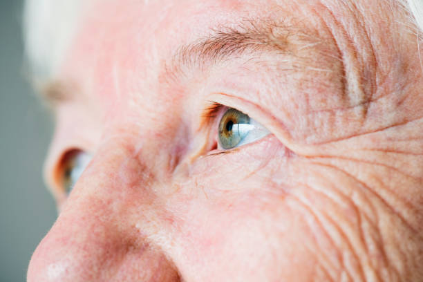 Closeup side portrait of white elderly woman's eyes Closeup side portrait of white elderly woman's eyes eastern european descent stock pictures, royalty-free photos & images