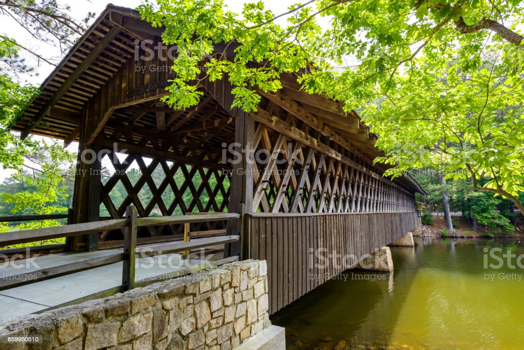 A close-up side view of a century old wood Covered Bridge in Stone Mountain State Park, Atlanta, Georgia, USA. stock photo