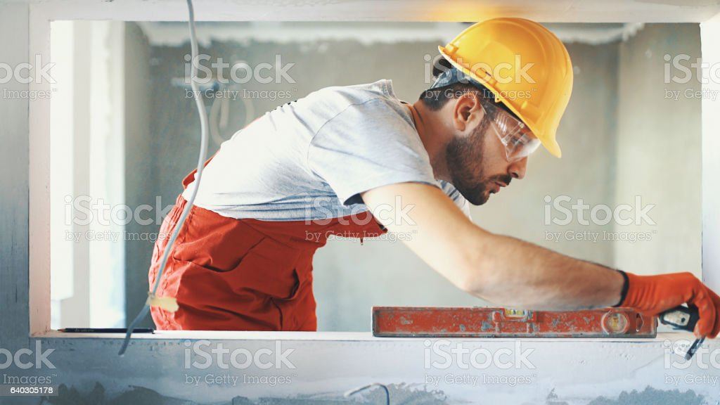 Closeup side view of a construction worker. stock photo