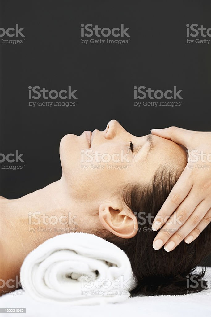Closeup side view of a woman receiving head massage royalty-free stock photo