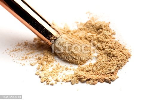 istock Close-up side view of professional make-up brush with natural bristle and black ferrule with crashed eyeshadow isolated on white background 1081292914