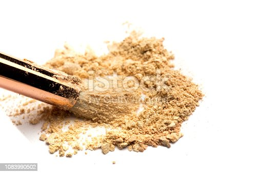 istock Close-up side view of professional make-up brush with natural bristle and black ferrule with crashed eyeshadow isolated on white background 1083990502