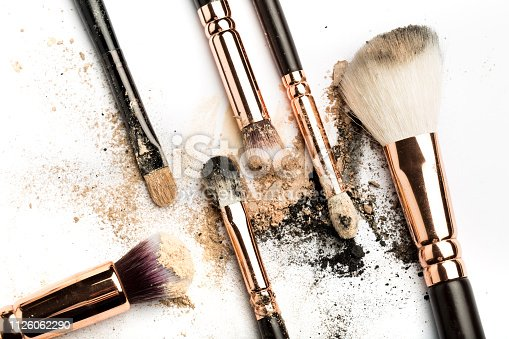 861986852 istock photo Close-up side view of professional make-up brush with natural bristle and black ferrule with crashed eyeshadow isolated on white background 1126062290