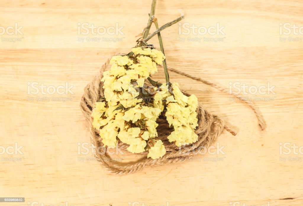 Closeup single of yellow statice flower background use for closeup single of yellow statice flower background use for decoration on small brown rope sack royalty mightylinksfo