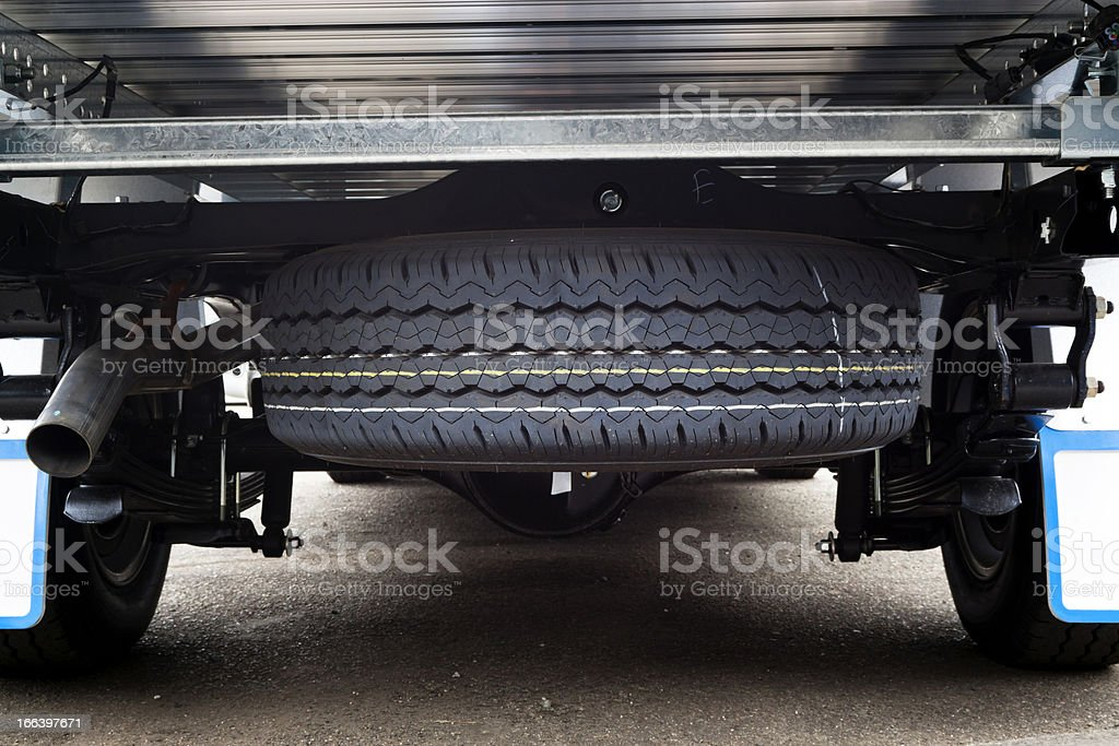 Closeup small truck spare tyre under the vehicle stock photo