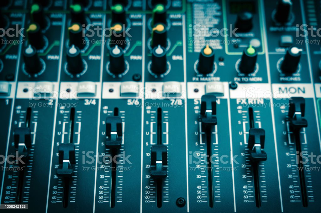 Closeup some part of audio mixer, vintage film style, music equipment...