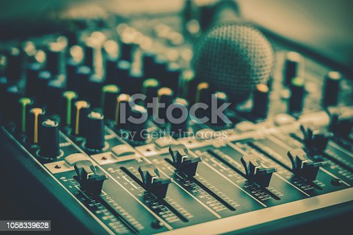 istock Closeup some part of audio mixer, vintage film style, music equipment concept 1058339628