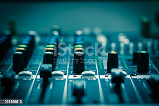 istock Closeup some part of audio mixer, vintage film style, music equipment concept 1091355510