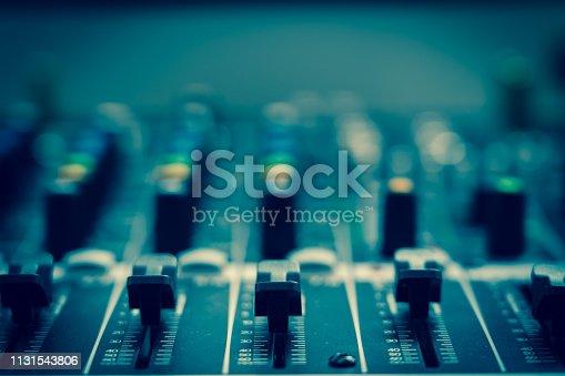 istock Closeup some part of audio mixer, vintage film style, music equipment concept 1131543806