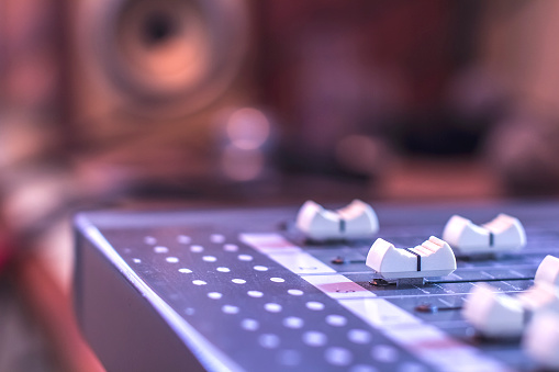 Close-up sound control buttons for professional sound engineers.