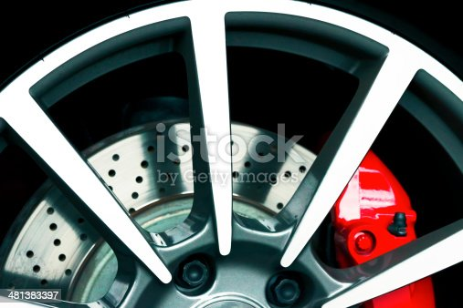 istock Closeup sports car alloy wheel with red carbon ceramic brake 481383397