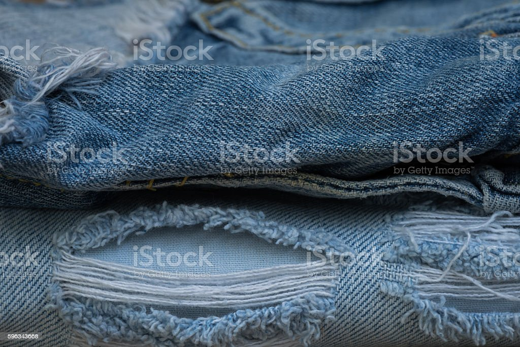 Closeup stack of old jean, Worn old jean royalty-free stock photo