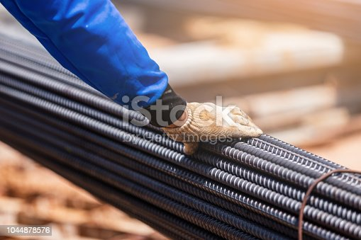 Industry outdoor building construction closeup hand work steel bars in site