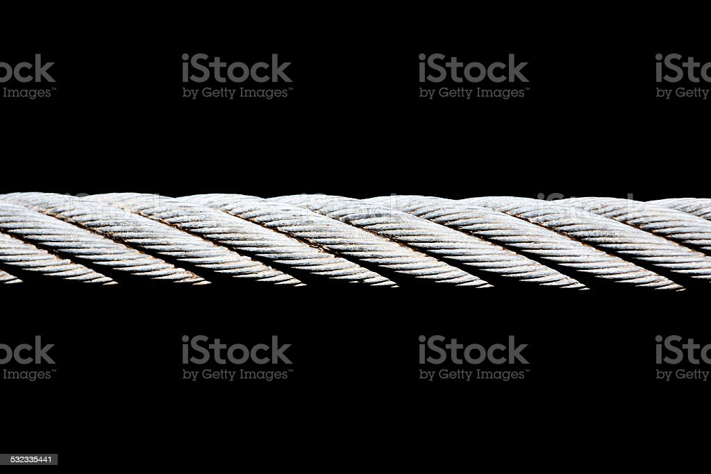 Closeup Steel cable against black background with copy space stock photo