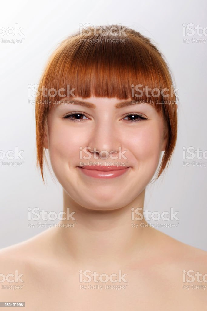 close-up studio portrait of a young beautiful woman demonstrating an emotion of joy, wide smile foto de stock royalty-free