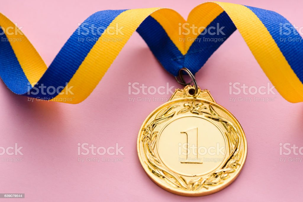 Close-up studio shot of number one golden medal stock photo