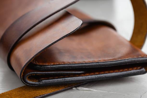 Closeup stylish handmade brown leather wallet stock photo
