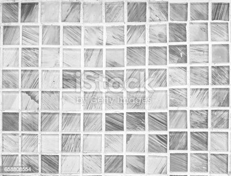 istock Closeup surface brick pattern at abstract tile in bathroom wall textured background in black and white tone 658808554