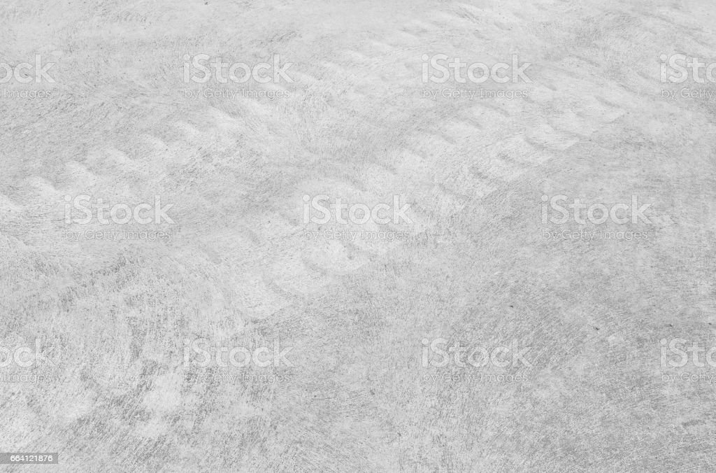 Closeup surface concrete floor with tire tracks textured background in black and white tone foto stock royalty-free