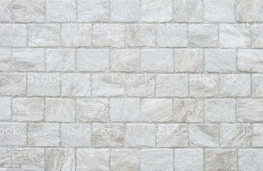 Closeup surface gray stone brick wall texture background foto royalty-free