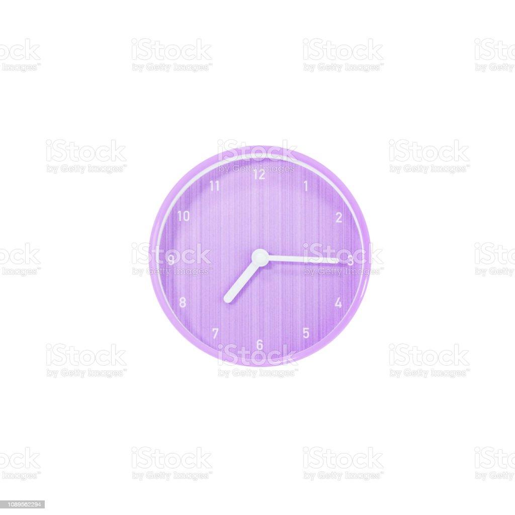Closeup surface purple circle wall clock show a quarter past seven or...