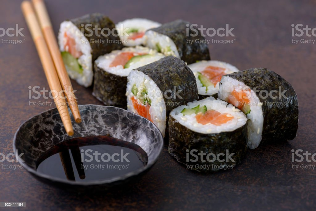 Close-up sushi roll with soy sauce stock photo