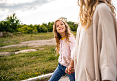 istock Close-up sweet girl walks with mother 1287876660