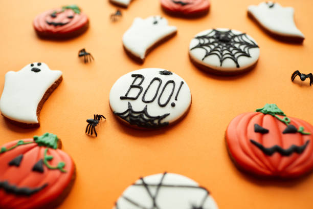 Close-up sweet sugar Halloween cookies with glaze, focus on Boo inscription written on cookie stock photo