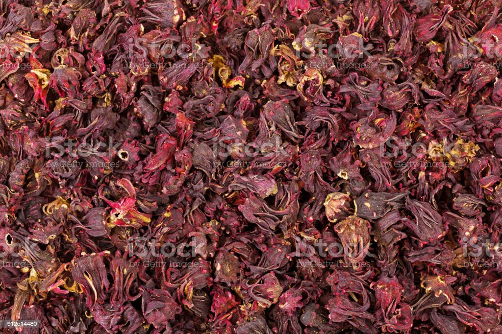 Closeup texture of dried Roselle hibiscus flowers in dark red color to make herbal tea stock photo