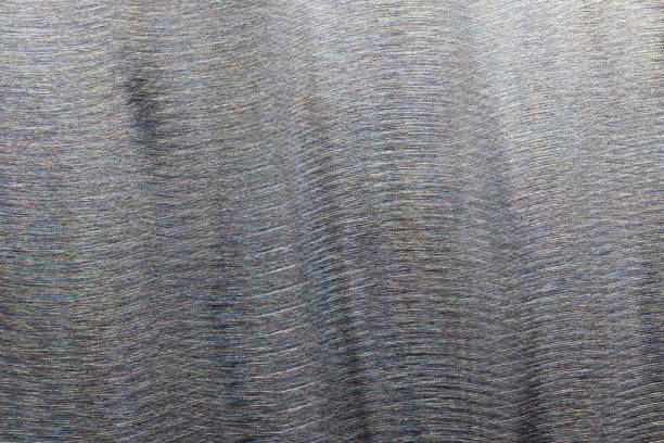 Close-up texture of flat steel surface manually cleaned with a flap wheel angle grinder. stock photo