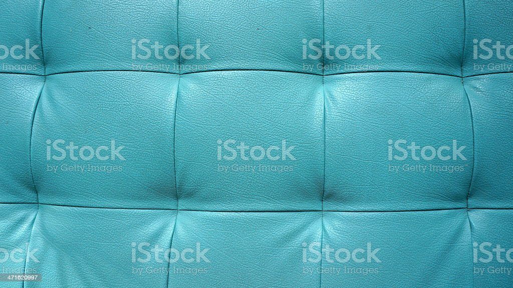 Closeup texture of vintage blue leather sofa for background royalty-free stock photo