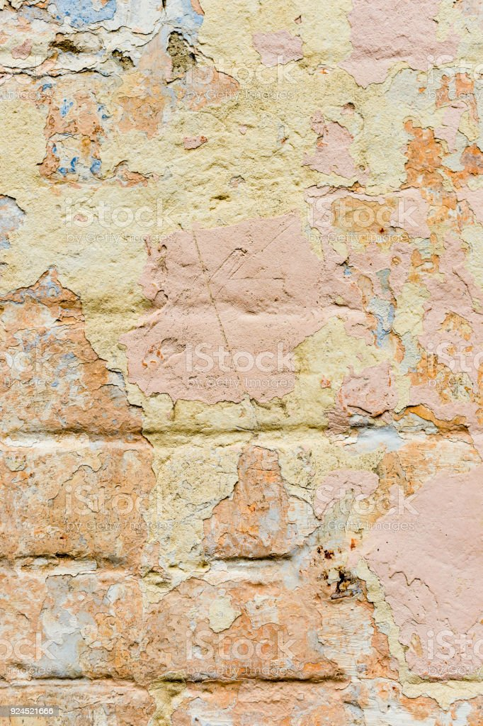 Closeup Textured Background Of Multilayer Flaking Paint On The Wall