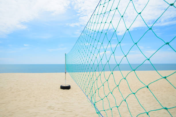 Closeup the beach volleyball net with cloudy and blue sky, Sport and nature concept, Selective focus stock photo
