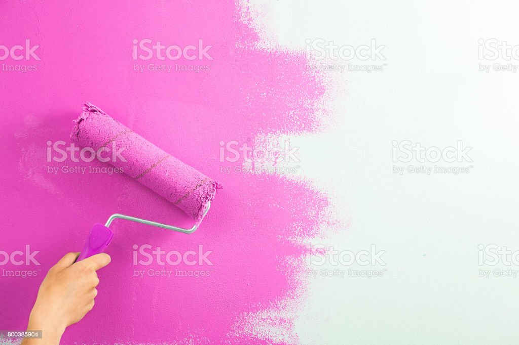 Close-up , the painter paint the wall of the room. stock photo