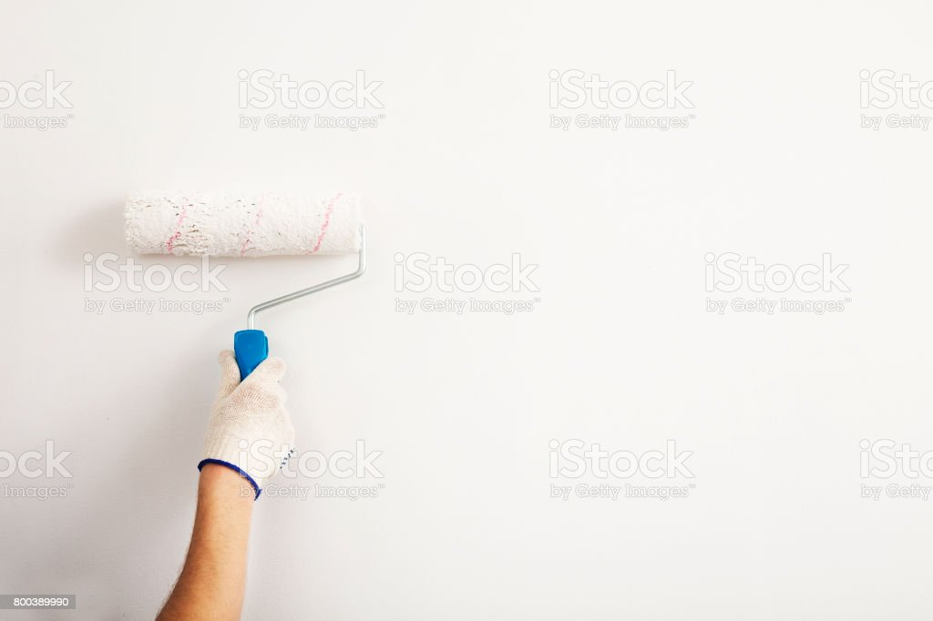 Close-up , the painter whitewashed the wall of the room. stock photo