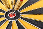 istock Closeup three dart target on bullseye 526707158