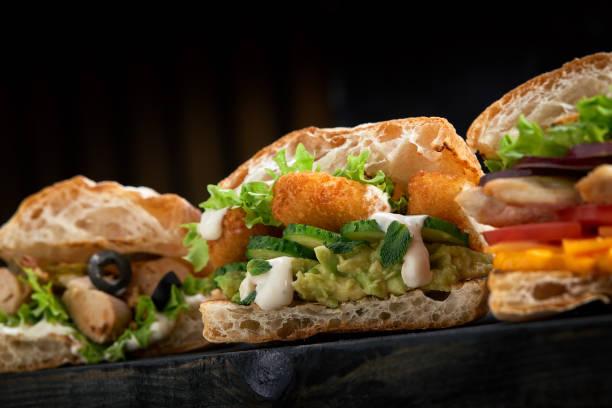 Closeup three different appetizing sandwiches or burgers on wooden picture id1221397649?b=1&k=6&m=1221397649&s=612x612&w=0&h=cuvqwvbz1 app 6nljvp1uwh9ldn1ijysdqizjpa4pg=