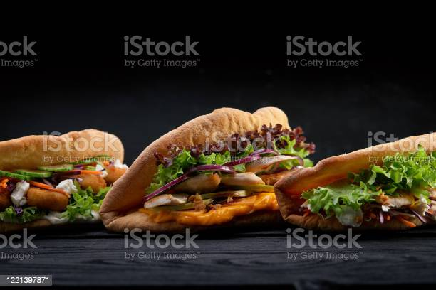 Closeup three different appetizing sandwiches or burgers on wooden picture id1221397871?b=1&k=6&m=1221397871&s=612x612&h=msswqp281urd ndlvr5n5a32xtantqeuyb2motlrxpe=
