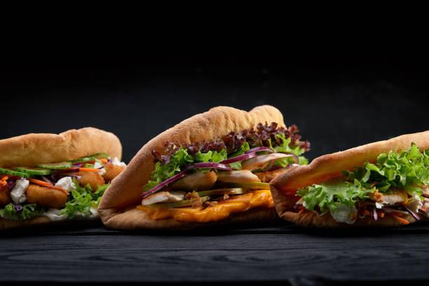 Closeup three different appetizing sandwiches or burgers on wooden picture id1221397871?b=1&k=6&m=1221397871&s=612x612&w=0&h=r2lncrltr3pkekztcvxxgj9zclv cupmvj9zlqu lgs=
