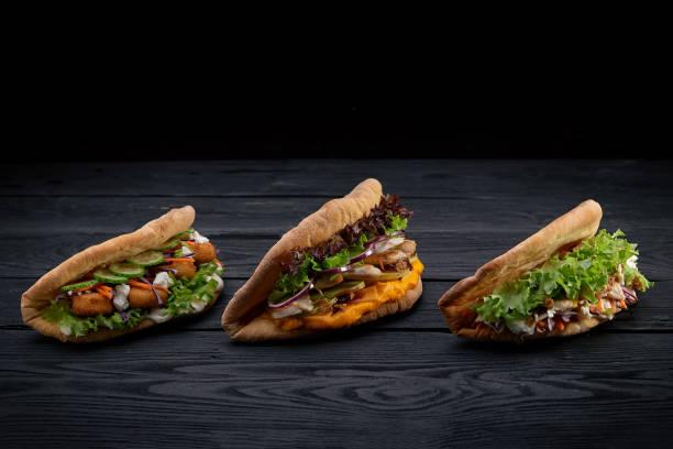 Closeup three different appetizing sandwiches or burgers on wooden picture id1221397900?b=1&k=6&m=1221397900&s=612x612&w=0&h=q87obmx bbdiluqxeoarcfvdoumdlqimr hrwzowucu=