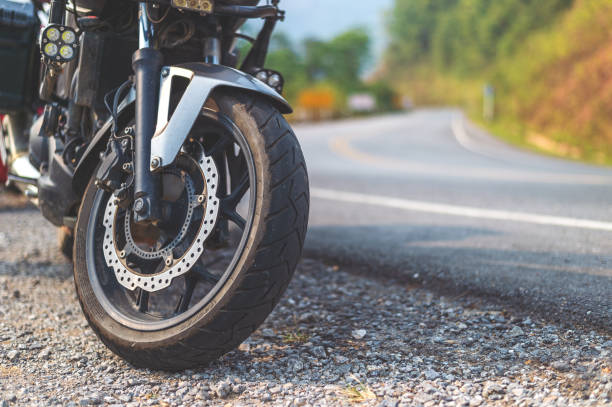 closeup tire of a bigbike with soft-focus and over light in the background – zdjęcie
